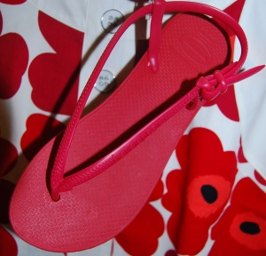 Make a statement with a pair of red Havaianas sandals.
