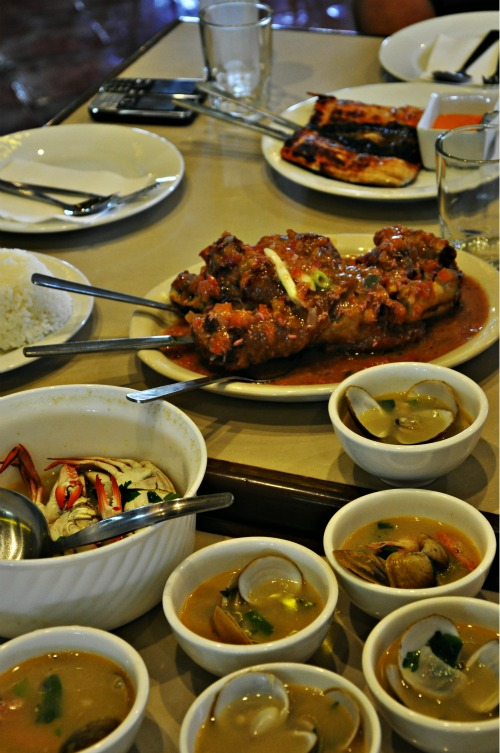 Dagupeña's legendary boneless bangus, binagoongang pata and Fisherman's Soup with malunggay, clams and crabs.